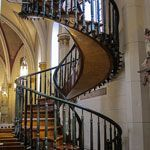 A look inside Loretto Chapel church built in 1878; famous for it's unusual helix shaped spiral staircase, the subject of mystery and allure. Located in Santa Fe, New Mexico.