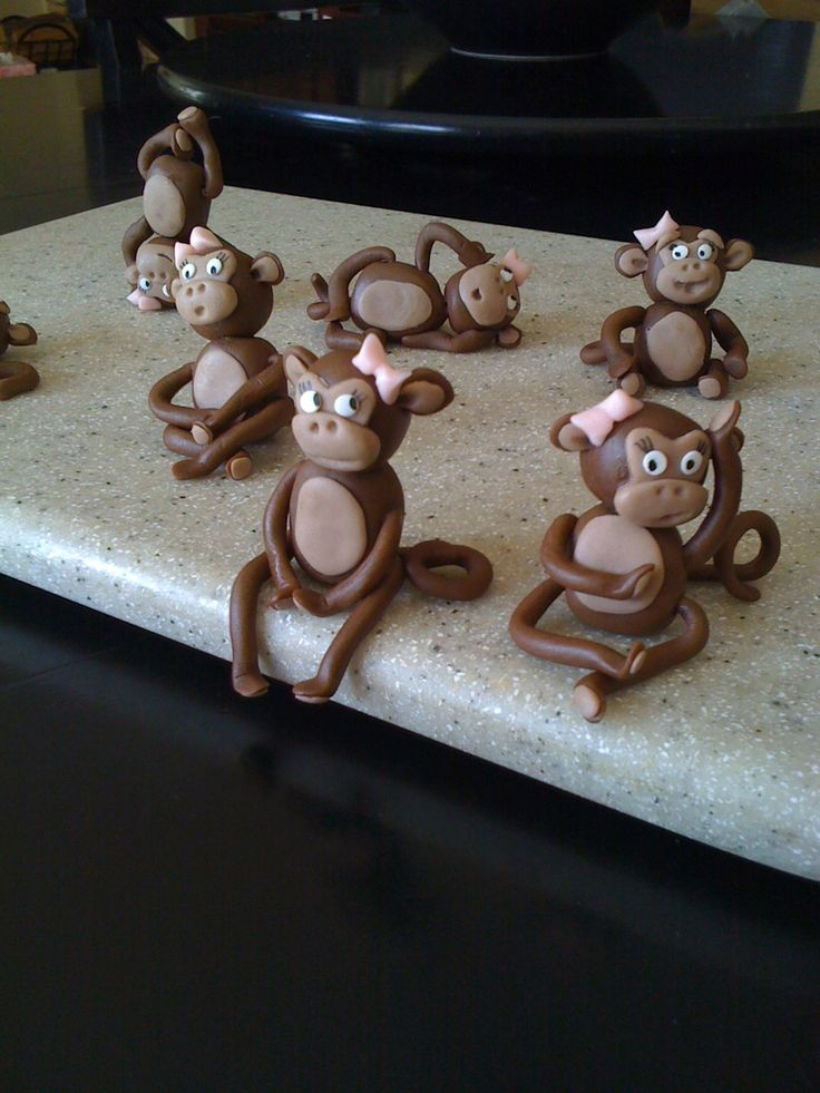 """Monkey Girls This is for my """"monkey"""" niece's b-day cake. Made out of chocolate fondant"""