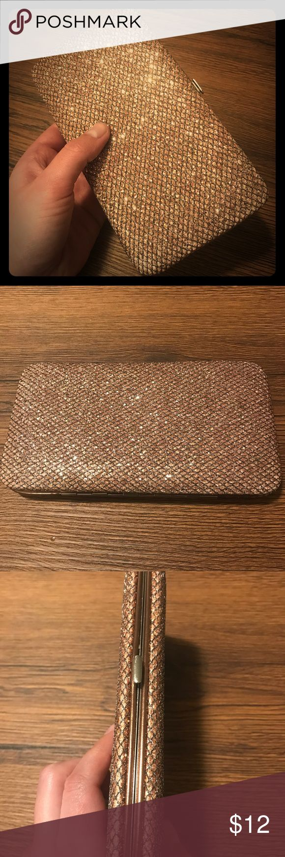 Rose Gold ✨Sparkly✨ Clutch Perfect new year's clutch!  In great condition, i took it out to a holiday party once years ago and just haven't used it since. 🤷🏻‍♀️  Comes across as more gold in the photos but is definitely rose gold.  Dimensions are approx 7x4x0.75in Bags Clutches & Wristlets