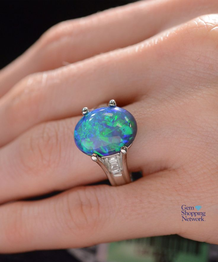 8.53 ctw Australian Lightning Ridge Black Opal Cabochon Oval & 0.23 ctw Diamond Platinum 13.80gr Ring Size 6.75  If you love being surrounded by exquisite jewelry then this is your dream destination. Gem Shopping Network is the most exquisite viewing experience on TV. Now available on live streaming and on apps.