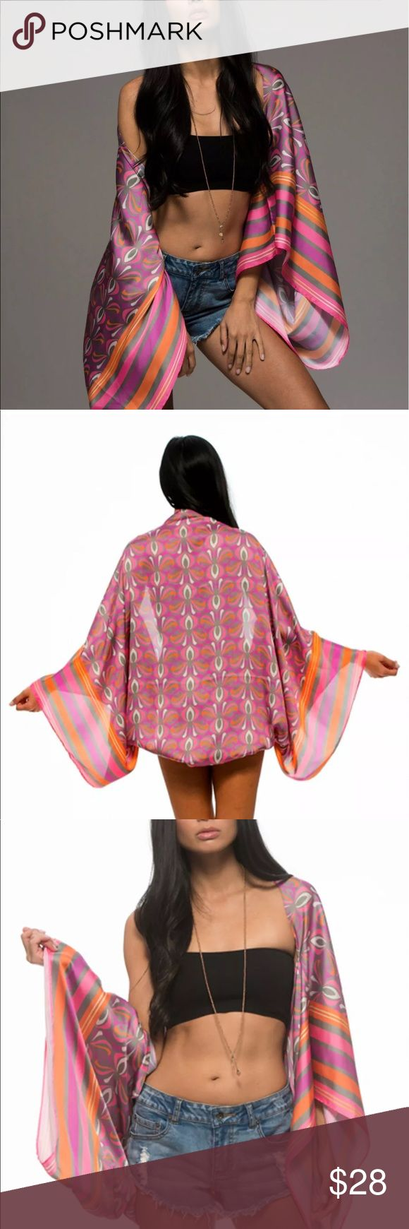 "Gypsy Lounge Pink Orange Satin Bolero Poncho Wrap Macbeth Collection Retail $60.00 The GIO BEACH BOLERO is your most versatile piece this season.  In a silky hand feel the vibrant prints are super luxurious.  Can be worn as a bolero / cape or a scarf.  Pair with the Matching Maxi (sold separately) Perfect piece to throw on with a tank and jeans,  Pop over a bikini or drape around your shoulders for dressy glam.  Shades of Pink, Neon Pink, Pale Olive, Tangerine 100% Polyester  Length: 56""…"