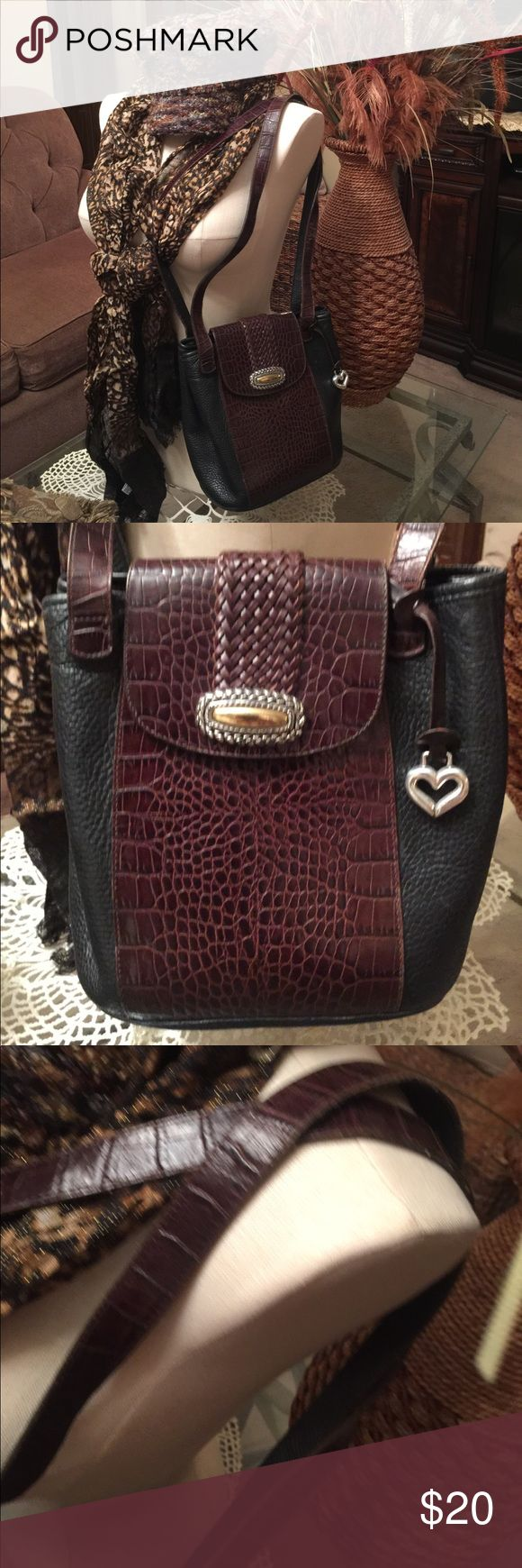 ✨Vintage Brighton Purse✨ 🔥🔥Priced to sell🔥🔥 Vintage Brighton Purse.  Clean, ornament on front closure shows slight tarnish.  Brown and Black.  Long should straps as seen in pictures.  Any questions please contact me.   Mild wear. Brighton Bags Hobos