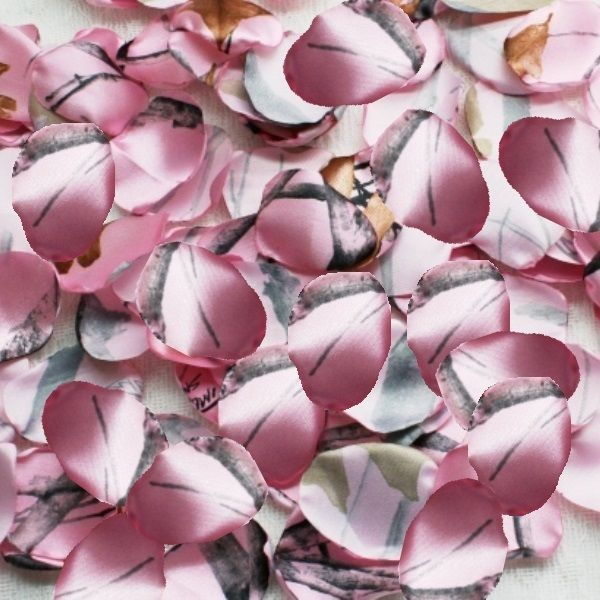 These pink snowfall camo rose petals are perfect for your camo wedding, or country wedding.  $9.95  There are 100 rose petals for your flower girl to toss, or for you to decorate with.   Other camo prints and solid colors available.