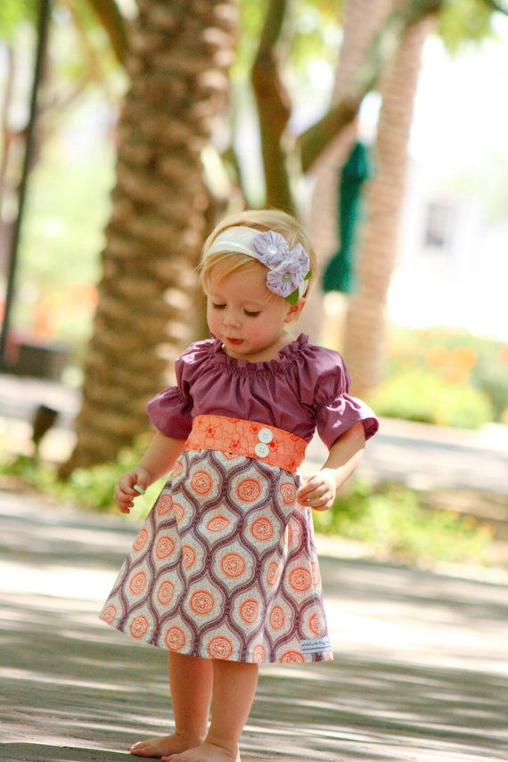 This dress is beautiful for the Fall. It is perfect for going back to school, Thanksgiving, photo shoots, pageants, parties, and play! The combination of the traditional colors of Autumn plums, oranges, peaches, and creams make this dress an eye catcher. Can be worn with or without the sash.