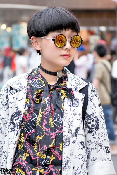 15-year-old Moeka on the street in Harajuku wearing a long Kobinai jacket over a…