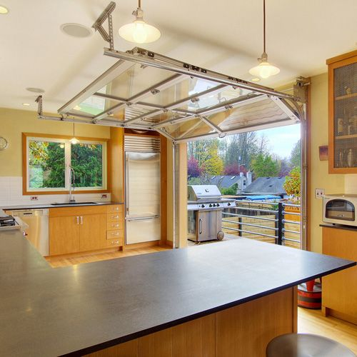 Kitchen Outside Doors: Cottage Industrial Home. Garage Converted Into The Kitchen, Garage Door Opens To The Deck
