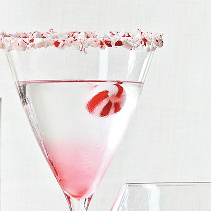 Candy Cane Martini -- 1 1/4 ounces vanilla vodka; 1 1/4 ounces white crème de cacao; 3/4 ounce peppermint schnapps; peppermint candy. Combine vanilla vodka, white creme de cacao, and peppermint schnapps in an ice-filled cocktail shaker. Shake vigorously, and strain into a cocktail glass. Garnish with peppermint candy.