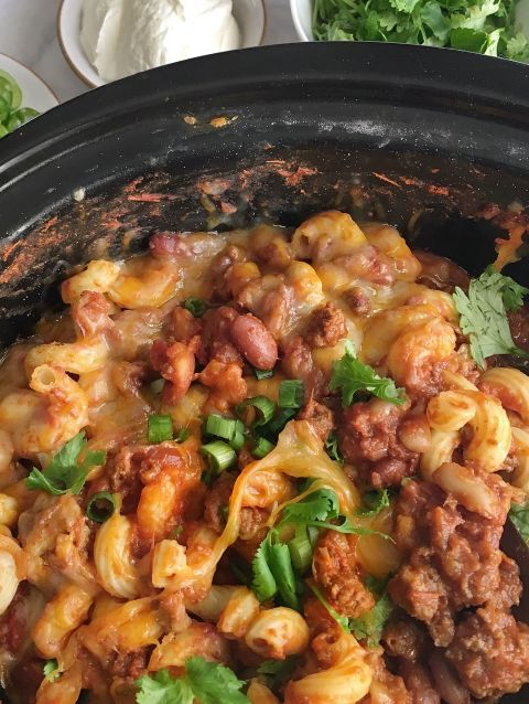 Put in a little bit of prep in the morning, come home to an insanely delish dinner. Get the recipe: Slow Cooker Chili Mac 'n Cheese
