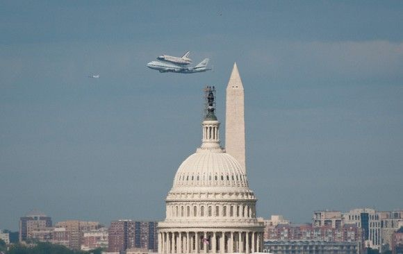 The space shuttle Discovery given a lift to its new home at the Smithsonian National Air and Space Museum as it flies over Washington D.C. Taken by Rebecca Roth/NASA