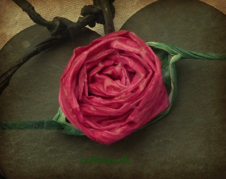 A delicate rose, a nice decoration for wedding tables. Handmade in Finnish paper thread.