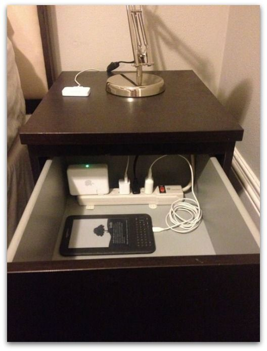 Power strip in bedside drawer - keeps the clutter away!