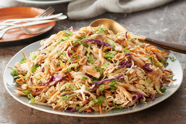 This fabulous-looking Asian Chicken Noodle Salad is easy to make, thanks to a coleslaw blend, a ramen noodle soup mix and a spoonful of peanut butter.