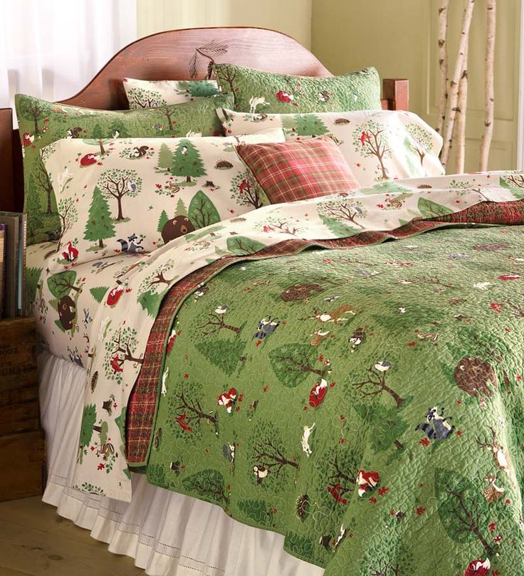Woodland Friends Cotton Quilt Set - A lovely design features a forest of furry friends, including deer, foxes, bears, rabbits and more on a green background with red plaid backing. This quilt has so much personality!(cost: 139.99)