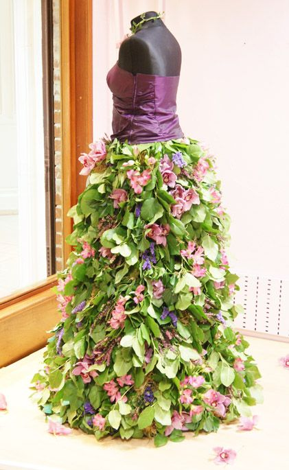 A unique, bespoke floral display for a special business promotion. A dress of real flowers: orchids, alstroemeria and heather. Florissimo, Shropshire