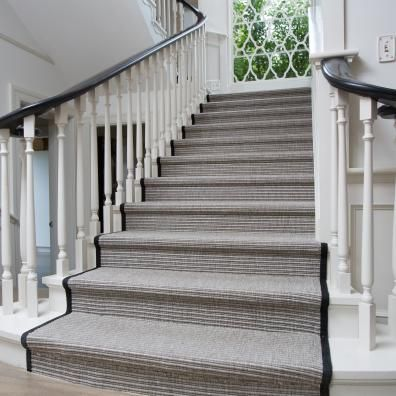 This beautiful home reflects the grandeur of an established Remuera property with a  contemporary finish. The stair runner was custom designed to suit the client's requirements. Smartly bound in black jute to emphasize the strong lines of the hand rail. The silver/grey of the Kindu Flatweave is a perfect match for a busy family home. Kindu offers durability as a Solution Dyed product in a high traffic area, along with a gorgeous natural appearance.  www.artisanflooring.co.nz/rugs/7003-RUG/