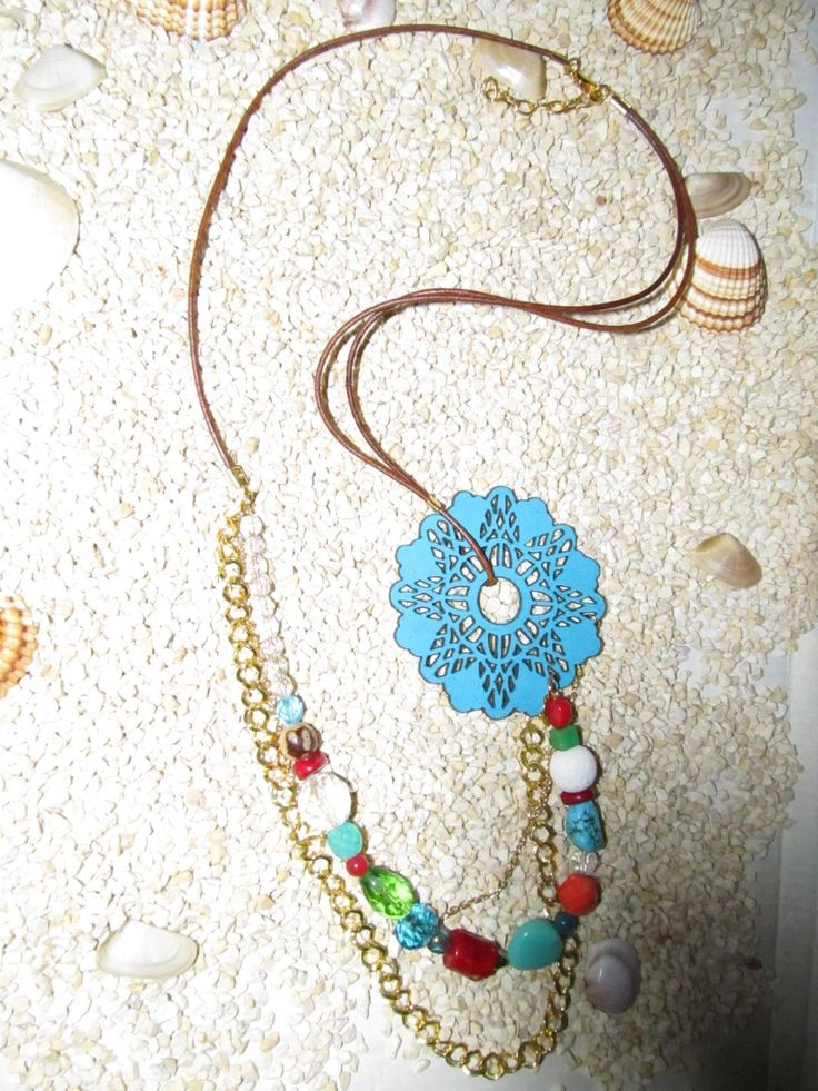 Handmade long necklace with turquoise leather filigree (1 pc)  Made with turquoise leather filigree, leather cord, chains, semiprecious stones and glass beads.