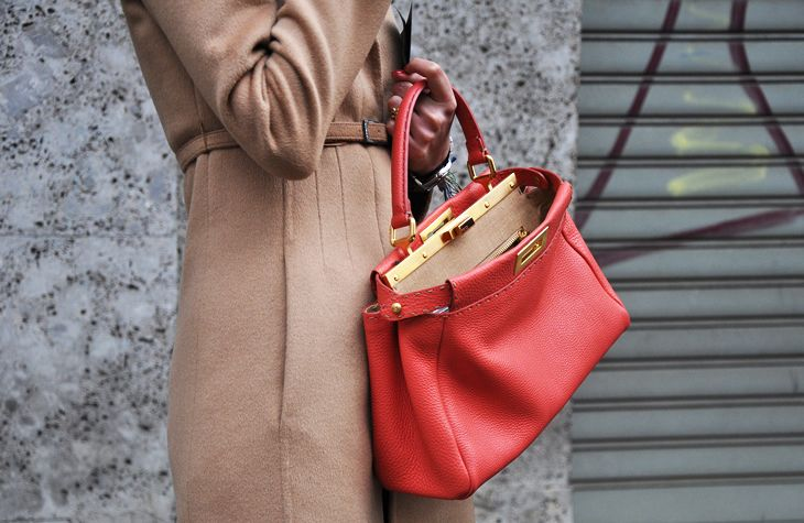 die for this color combination...classic camel coat with a bright ladylike fendi bag