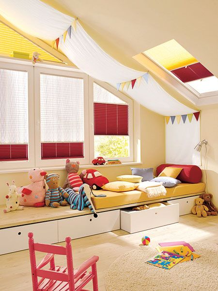 playroom or kids room idea - especially for an attic space - may use for game room - provides seating and storage:)