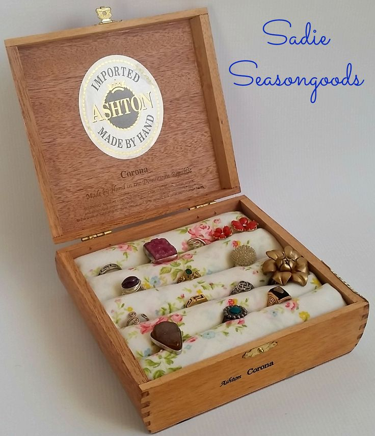 A vintage cigar box serves as a quirky, fun ring holder with a little quilt batting and pretty fabric. A low-sew easy upcycle anyone can do- love jewelry organization craft projects! #SadieSeasongoods
