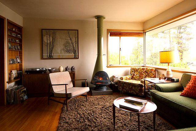 Orange floral, shag rug, fire place.