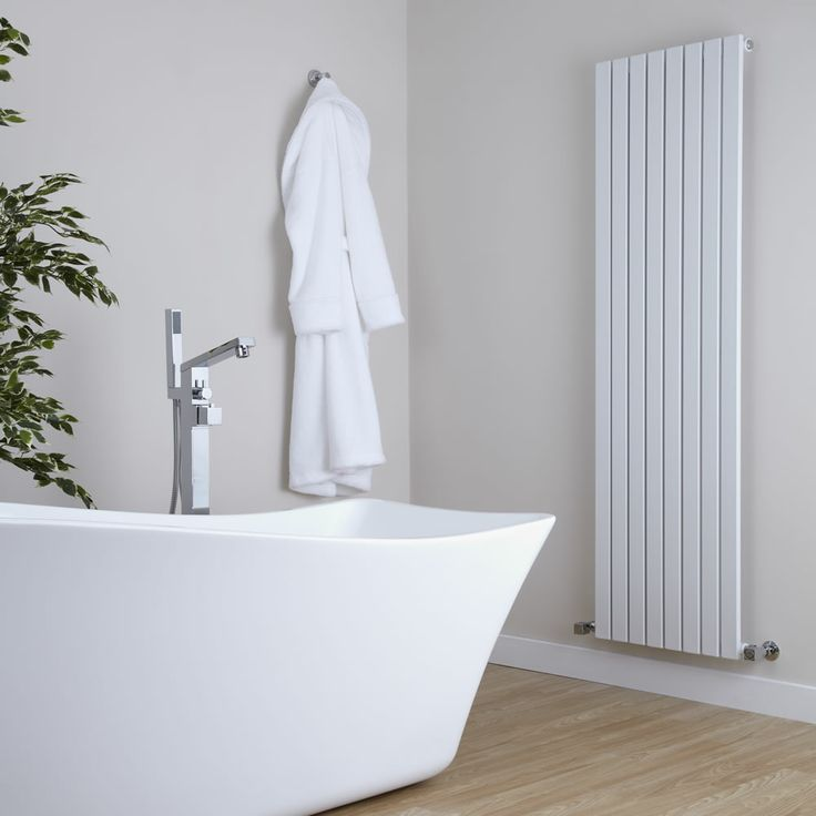 This beautiful white radiator perfectly complements this bathroom.