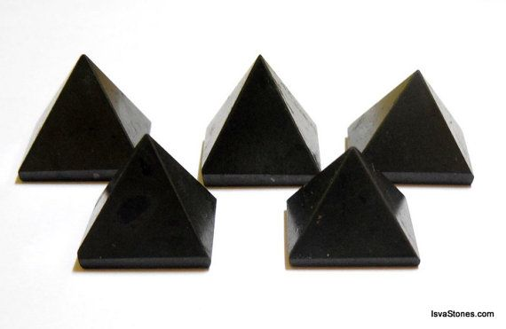 I've never seen Black Tourmaline like this before! How cool for a body layout or crystal grid!  Black Tourmaline Pyramid Set of 5 for Chakra Healing by IsvaStones