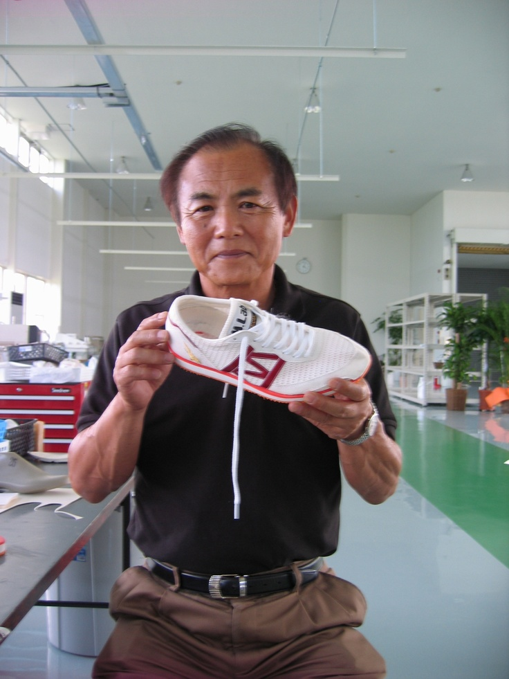 Hitoshi Mimura, former master shoemaker at ASICS, shows me his new shoes. He is now at Adidas.