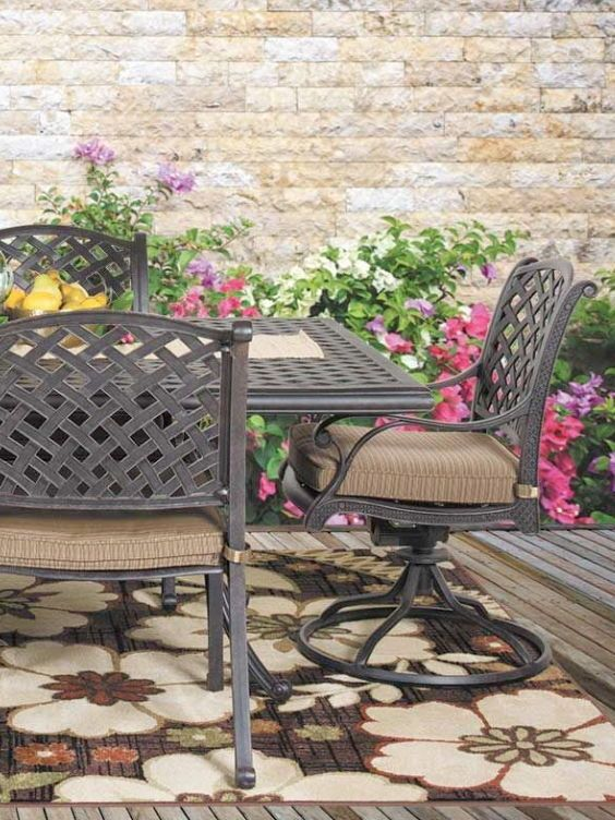 Embrace The Outdoors With Castle Rock 52 Round Patio Table By World Source A Lattice Patterned Top Flared Legs And Black Powder Coat Finish Evoke