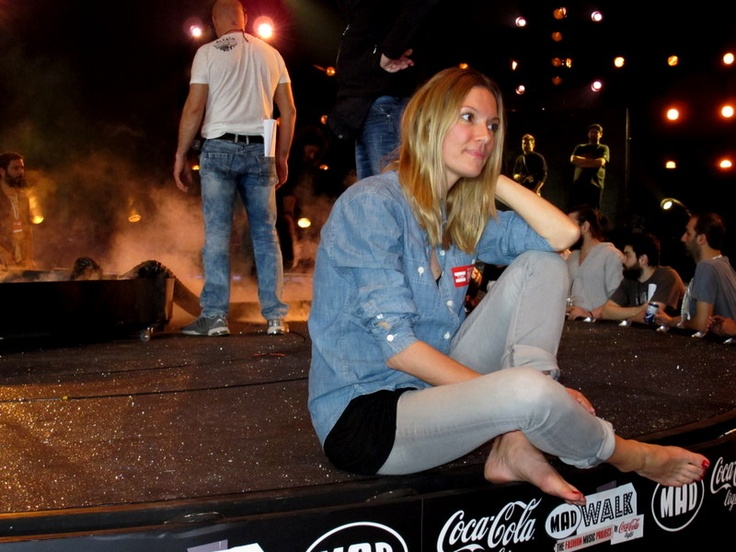 Vicky Kaya on the stage of MadWalk 2013, filming for TOM's One Day Without Shoes