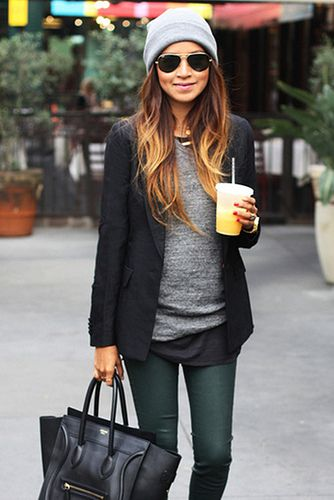 Light grey knit sweater with a charcoal-colored structured jacket & green pants