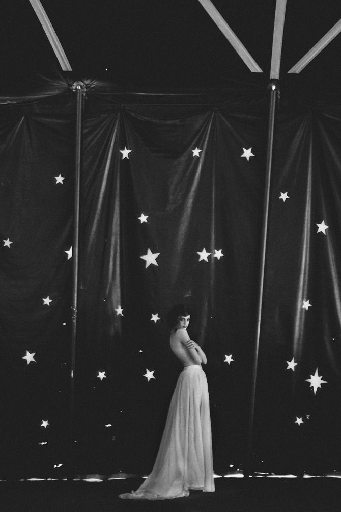 She says nothing at all, but simply stares upward into the dark sky, and watches, with sad eyes, the slow dance of infinite stars. Neil Gaiman