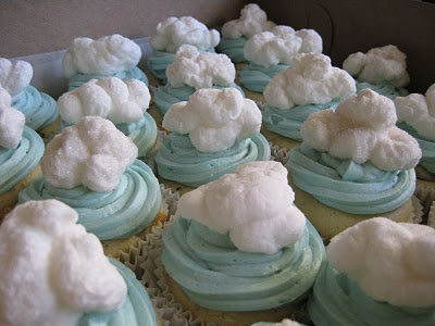 Cupcakes with piped marshmallow clouds