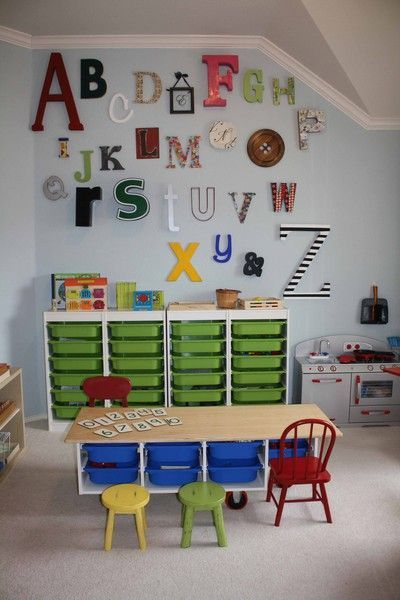 This is apparently a Montessori Homeschool Room. What's awesome is that my finished basement/playroom/craftstudio looks SO much like this! Maaaaaaybe I should homeschool my kid....!? ;o)