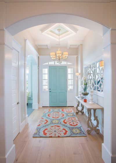 Such a cool way to incorporate color and to make rooms flow. Notice robin's egg color to the left in LR Love the ceiling medallion, light fixture and the mirror on the wall.
