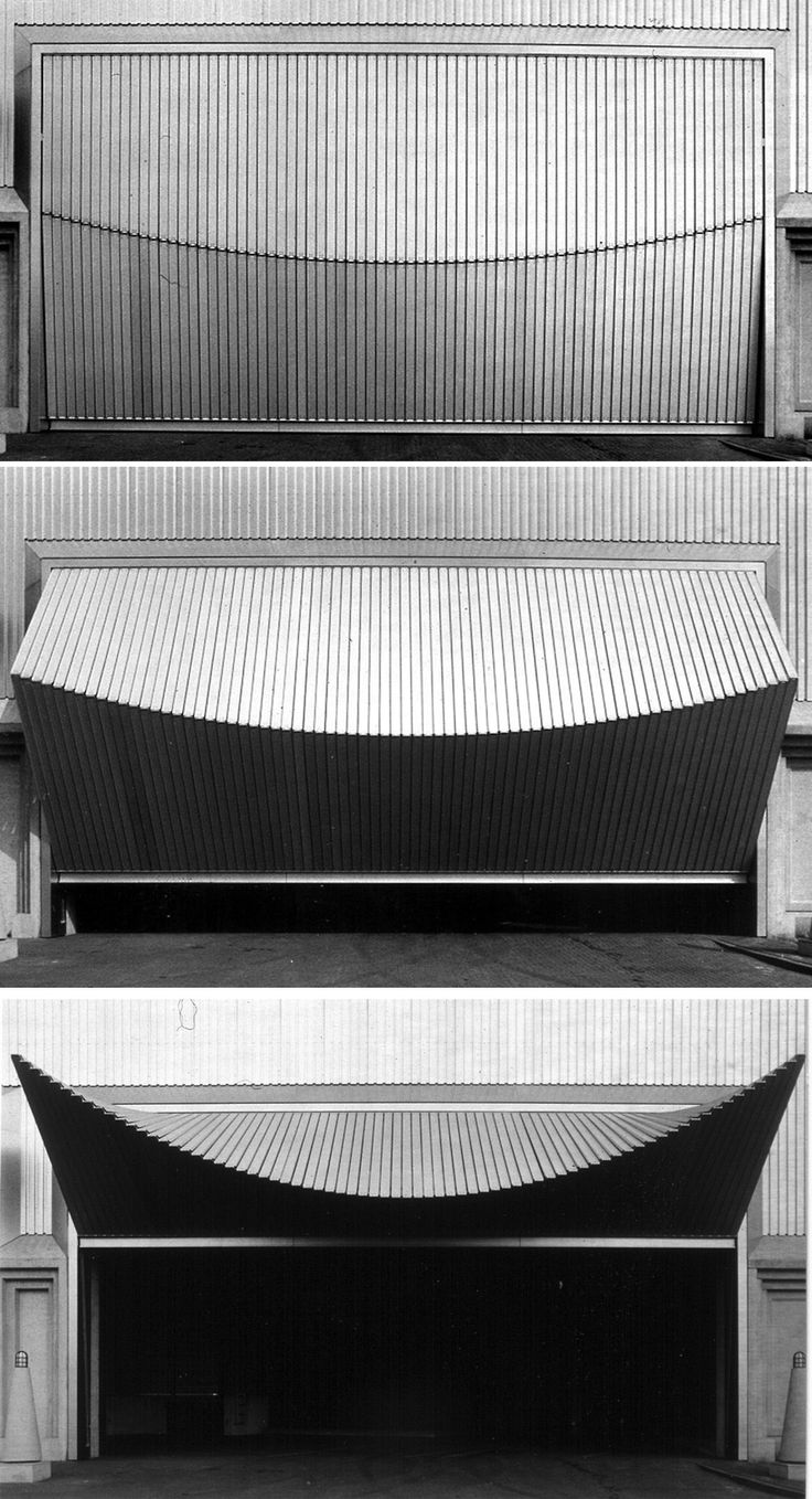 "Santiago Calatrava + Fabio Reinhardt + Bruno Reichlin | Loading bay doors. Warehouse of Ernstings factory, 1983-1985 Coesfeld-Lette ""These bay doors were the first application of an idea that originated in a sculpture by Calatrava; a form based on the shape of the human eye.   Here, the form became an experiment in kinetics, used to investigate the mechanical transformation of planes in a building."" Via 1"