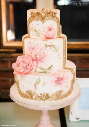 make the cake ivory/almond with the front panel white with painted boanitcals in slate/blue and a gold frame...