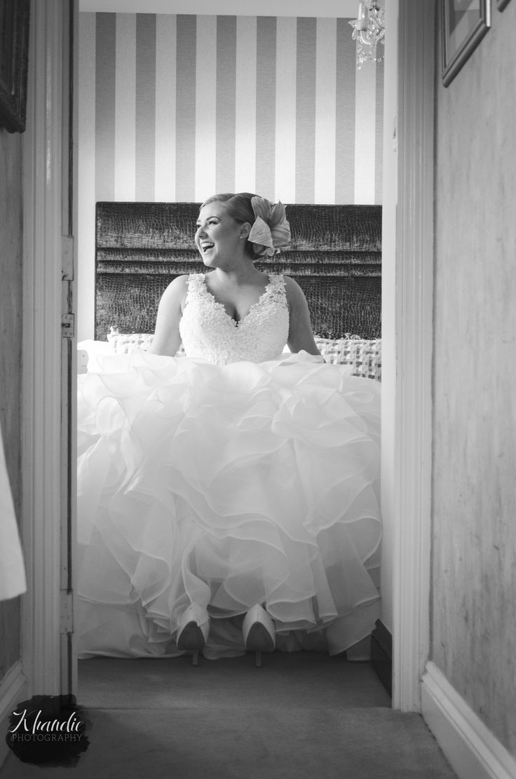 smiling candid photojournalist natural portrait of the bride. Wedding photography by Khandie Photography. http://www.khandiephotography.com copyright Khandie Photography. Northampton, monochrome, mono,