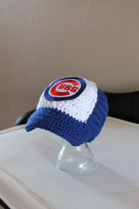 This adorable baseball hat is perfect for your favorite little Cubs fan! It makes an adorable photo prop or a great baby shower gift! Looking for a different team? Please contact me!  This item comes from a smoke free home. It is made to order, please see shop banner for current processing time.  Thanks for looking and be sure to check out my Facebook page: facebook.com/pages/That-Girls-Crafts/156683961115756