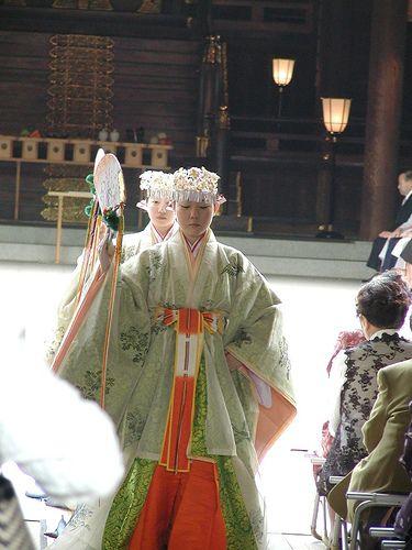 Miko dressed in junihitoe dancing.