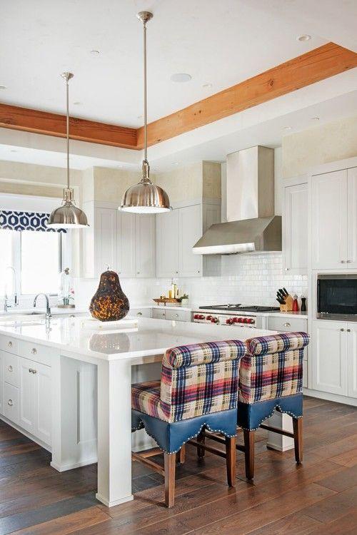 Southwestern kitchen with white island counter and hardwood floors