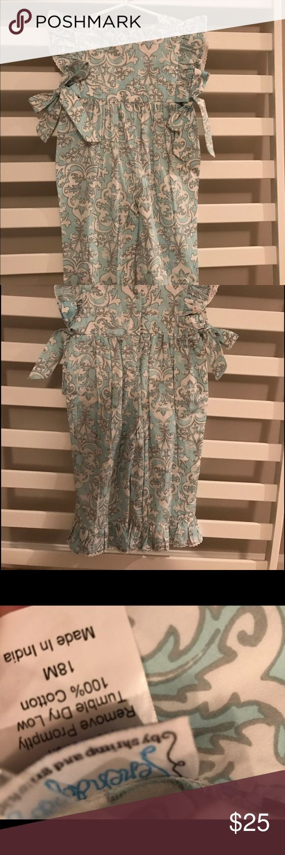 Shrimp and grits kids romper Serendipity by Shrimp and grits kids, romper with bows on the side, ruffle sleeves and ruffles and the bottom. Shrimp and Grits Kids One Pieces