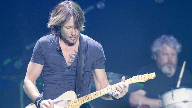 Caboolture boy turned country-rock crossover star Keith Urban delivered generority - and quite a few guitar solos-  to a packed house at the start of his Australian tour, at the Brisbane Entertainment Centre on Friday, January 25, 2013.