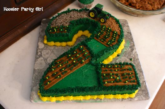 John Deere farm tractor birthday cake. Love it!! got to find someone that can do this for number 4. I'm sure he'll still be into tractors and farming.