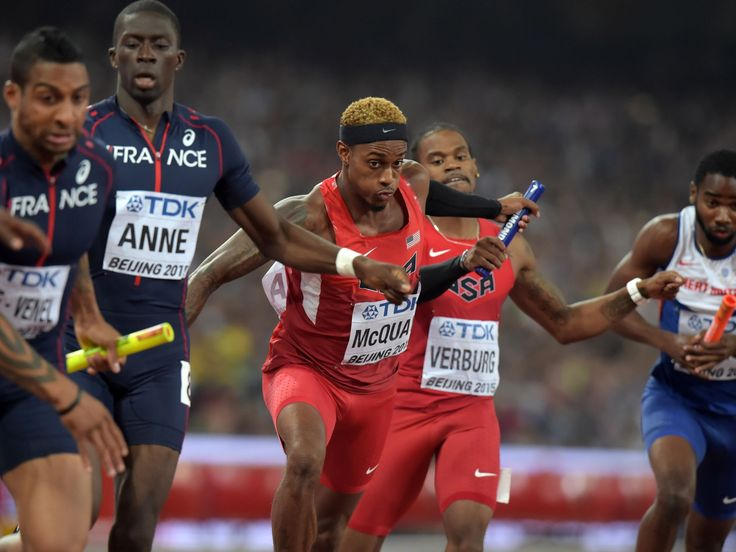 Tony McQuay takes the handoff from David Verburg on the second leg of the United States 4 x 400m relay that won in 2:57.82 during the IAAF World Championships in Athletics at National Stadium.   Kirby Lee, USA TODAY Sports
