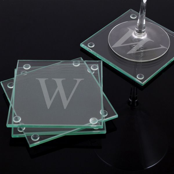 Engraved glass coaster set that boasts your last name initial