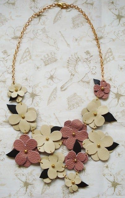 leather flower necklace. Could be a DIY with scrap leather. would work in other colors and just wear it with a tshirt and jeans