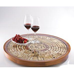Beautiful cork tray~~~could make with large clay pot saucer, glue halved corks with E-6000 waterproof glue, then glue piece of glass cut to cover cork design...DYI!!!