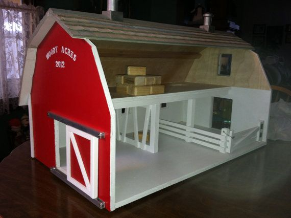 Childrens toy wooden barn. We would like to build a toy barn for our schleich animals like this one. I have one that was kinda like this. but much less complicated.