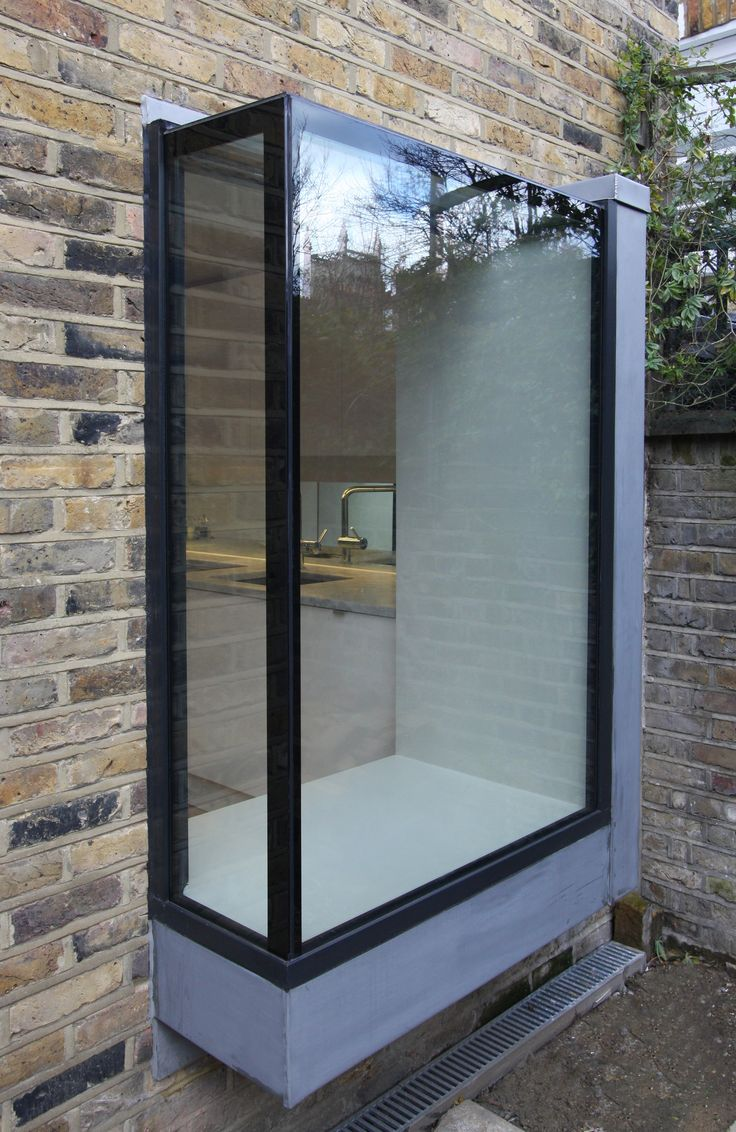 frameless glass box seat to residential property www.iqglassuk.com