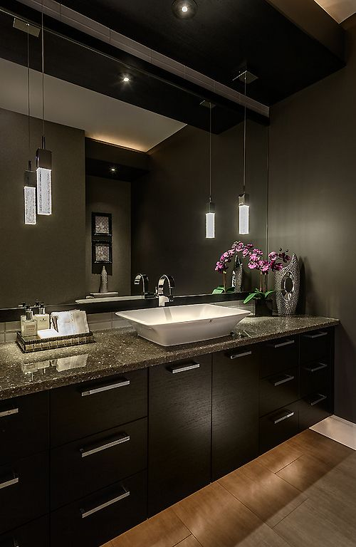 Young Sophisticated Luxury... like it when the granite is darker and closer to the dark wood cabinets...
